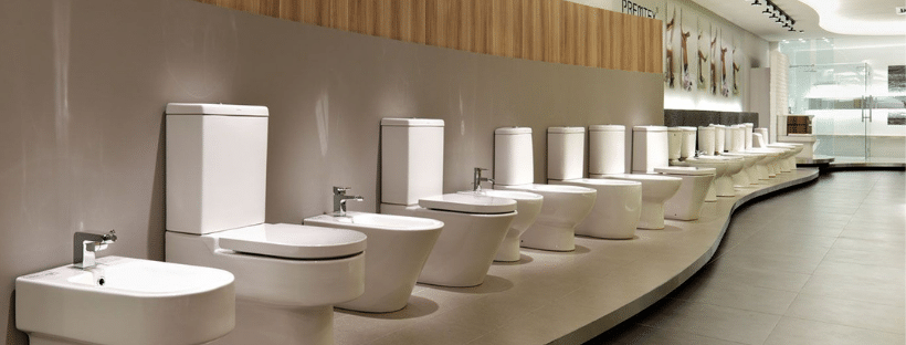A range of toilet styles in a showroom
