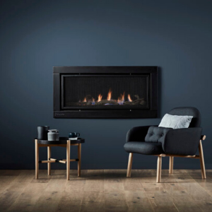 Wall fitted fire place with two easy chairs